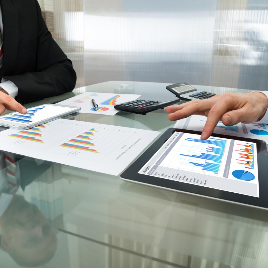 Two Businessman Working On Digital Tablet