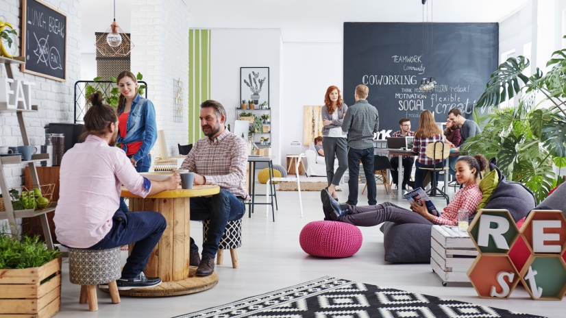 People working in modern agency relaxing during lunch break